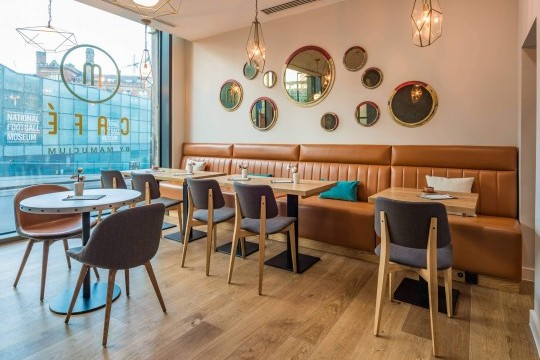 Sonny chairs with wooden legs and Joe chairs with wooden legs in the M Cafè of the Hotel Indigo in Manchester