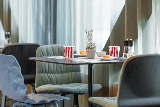 Liù chairs at Radius Hotel's restaurant in Tibilisi